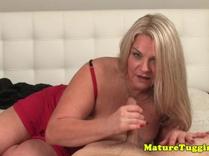 Busty mature sensually rubbing..