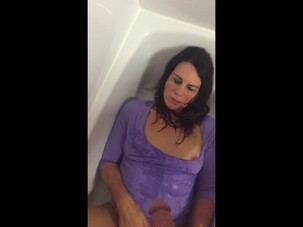 Mature woman is pissed on and..